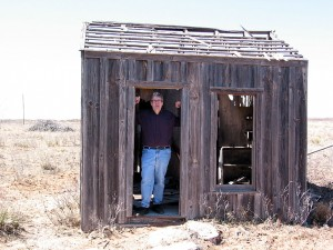 Writer Scott Edelman stands in the doorway of the shack where Jack Williamson wrote the first science fiction story to feature antimatter.  Photo courtesy of Scott Edelman.