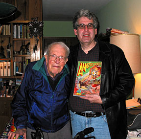 Jack Williamson, then 95, poses with Edelman and a copy of the December 1928 Amazing Stories magazine, which contains his first published story. Photo courtesy of Scott Edelman.