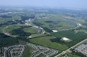 The Tevatron collider at Fermilab, four miles in circumference, accelerates protons and antiprotons close to the speed of light and makes them collide.