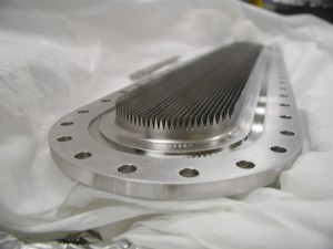 This insert, manufactured by SLAC and the company EMEGA, was placed inside the KEK-B accelerator beam pipe to trap stray electrons with its triangular grooves. (Photo by Mauro Pivi.)