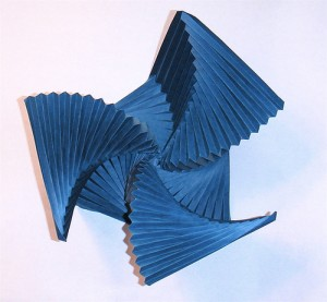 An iso-area hexagonal collapse, twisted into a 3D shape and held there via wet folding.