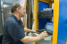 Al Legan of Fermilab's Accelerator Division Controls Department, remotely operates the device.
