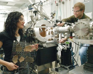 Lori Khatchadourian (University of Michigan) and Adam Smith (The University of Chicago) switch sample mounts at the ChemMatCARS 15-ID-D beamline. The samples are from one of Smith's excavations in Armenia and date to 1300 B.C. Smith's group is analyzing relics from northern China, the southern Urals, and the south Caucasus. The group's goal is to determine the utility of APS analysis to examining large assemblages of mundane objects from different parts of the past. Credit: Argonne National Laboratory