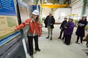 MicroBooNE spokesperson Bonnie Fleming explains the secrets of neutrinos to a group of journalists inside the MINOS above-ground facility.
