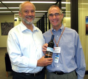 Doug Glenzinski, right, with Fermilab Director Pier Oddone -- and a very special vintage