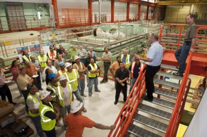 Construction workers gather for a safety briefing in the Fermilab test accelerator facility.