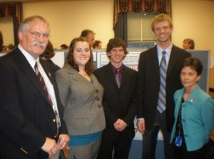 Pictured left to right: Scott Borg of the NSF Office of Polar Programs; students Samantha Jakel, Kyle Jero and Drew Anderson; and Bonnie H. Thompson, program manager of the Office of International Science and Engineering. <em>Photo courtesy of Kyle Jero.</em>