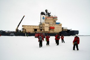 Passengers gather outside the ship that transported the particle detector -- and students -- to Antarctica. <em>Photo courtesy of Kyle Jero.</em>