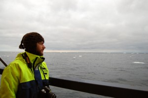 Kyle Jero during his weeks-long stint aboard the Oden icebreaker last winter as it travelled from Sweden to Antarctica, carrying a small particle detector. <em>Photo courtesy of Kyle Jero.</em>