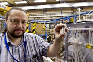 Detlef Kuchler, a physicist in CERN's Beams department, with the container holding the purified sample of lead used to create heavy ions for the LHC. Photo: M. Brice / CERN