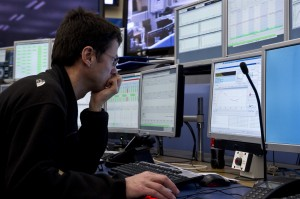 An operator monitors the LHC's performance in the CERN Control Center in March 2010. Image courtesy of CERN.