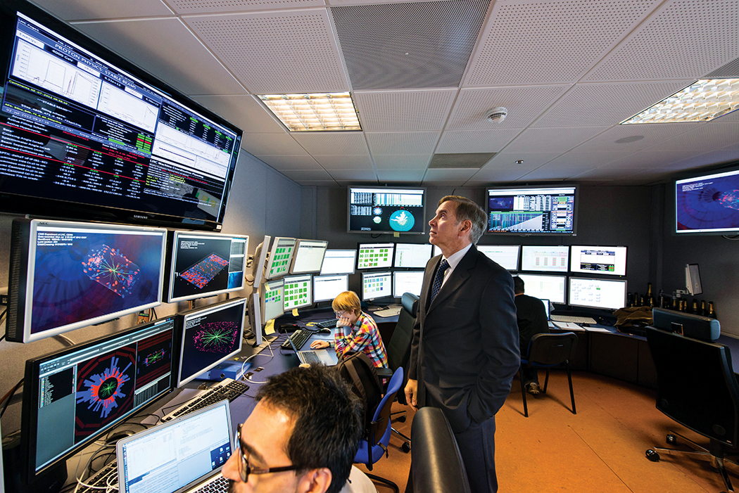 Photo of (CMS control room): physicist and CMS Spokesperson Joe Incandela watches a continually updating display of events