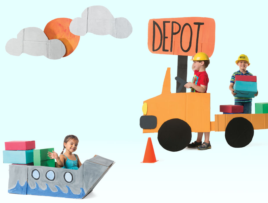 Photo of three children playing with cut-out of truck and shipping container