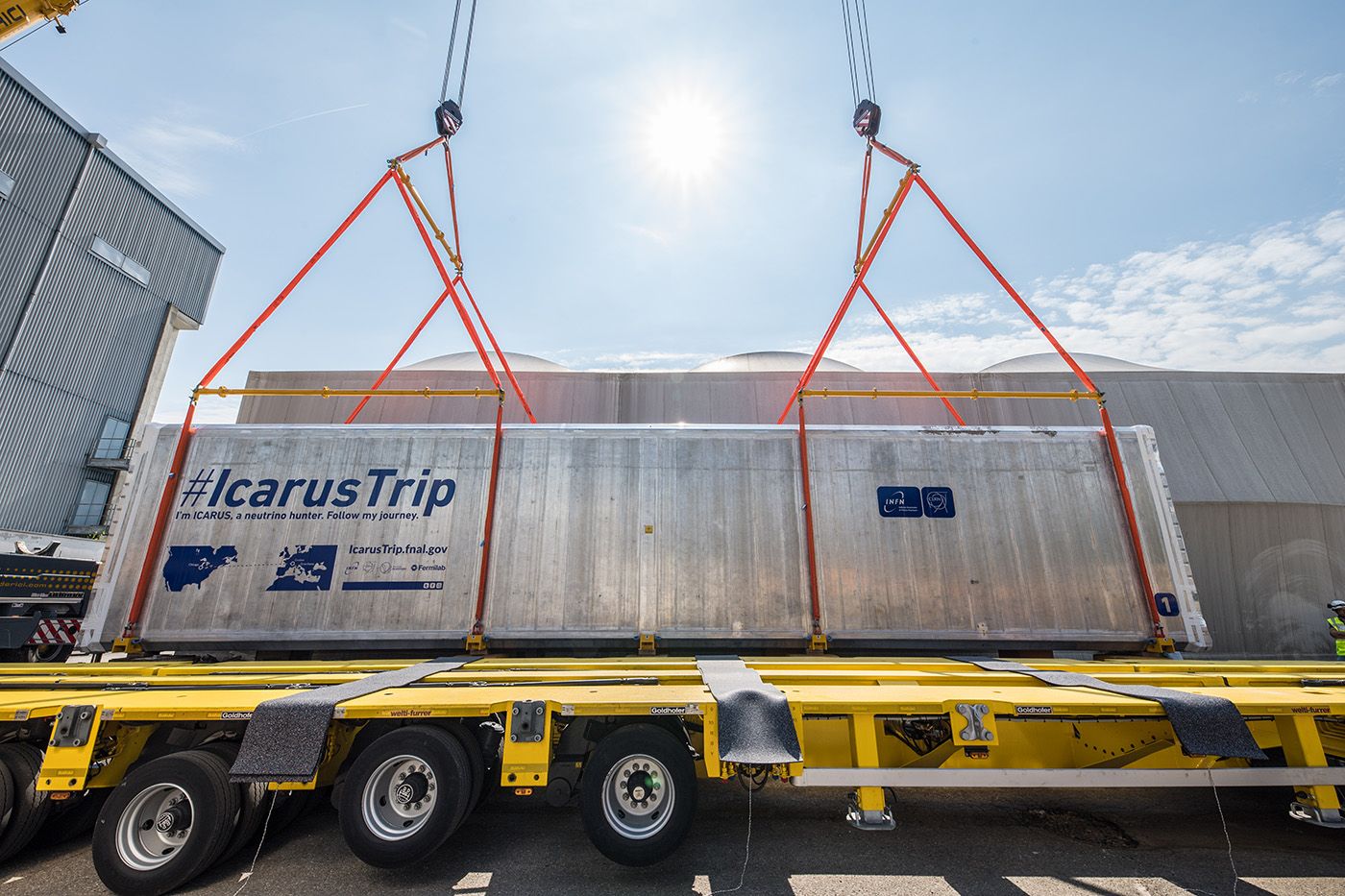 "Photo of a shipping container with the words ""Icarus Trip"" on the side"