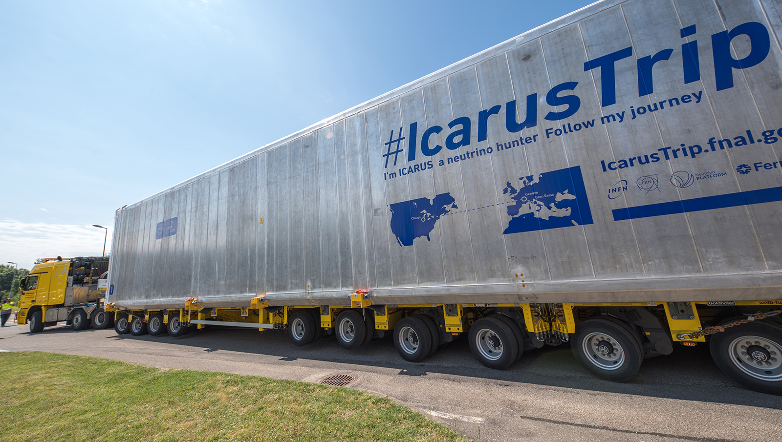 Photo of the ICARUS shipping container being transported by truck