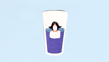 Illustration of penguin at the top of water glass on top of ice cube
