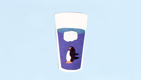 Illustration of penguin at the bottom of water glass beneath ice cube