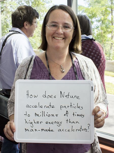 "Photo of Brenda Dingus ""How does Nature accelerate particles to millions of times higher energy than man-made accelerators?"""