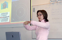 Students around the world participate in videoconferences, lectures, and analysis of particle physics data.