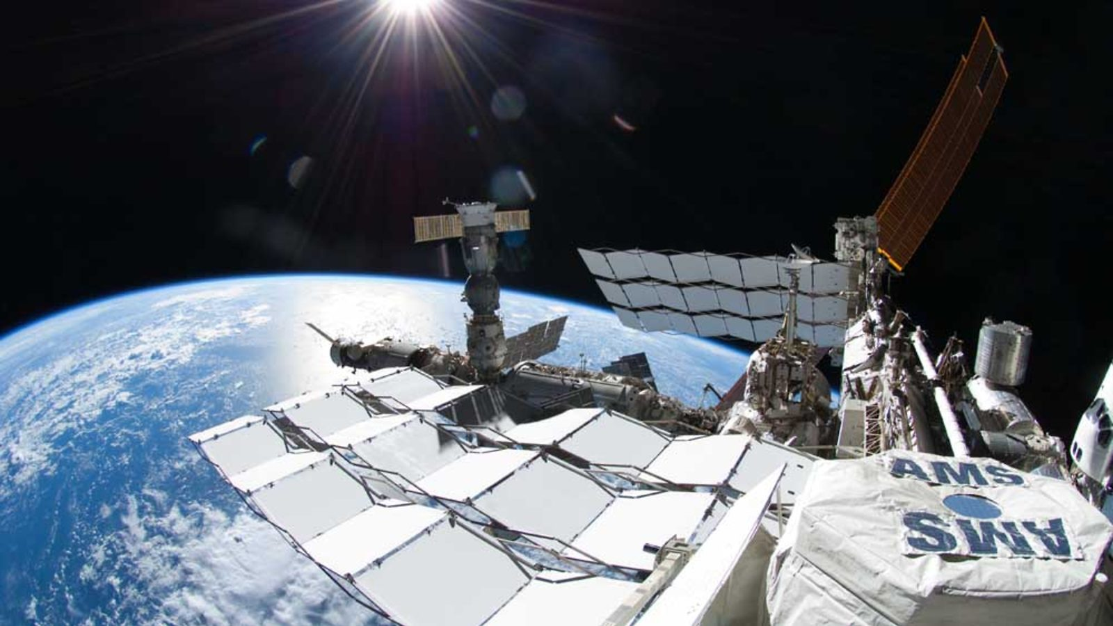 Photo of AMS on ISS outside of Earth's atmosphere