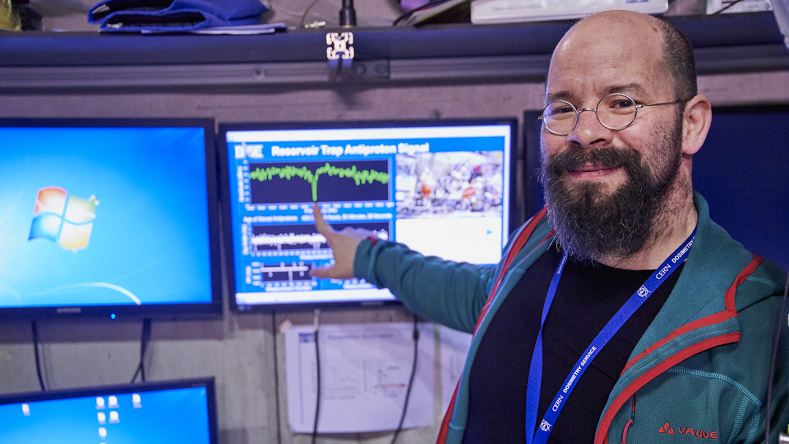 Stefan Ulmer, spokesperson of BASE collaboration, points at a screen with data about a 405-day-old antiproton