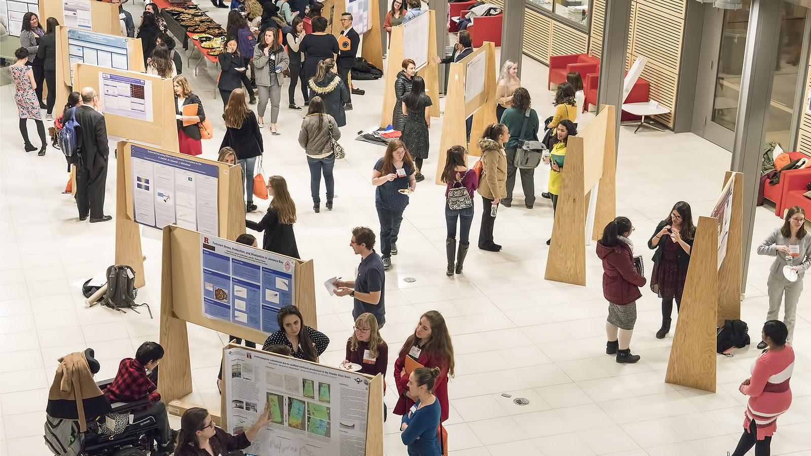 Photo of many CUWiP programs include a poster session where students have the opportunity to describe research