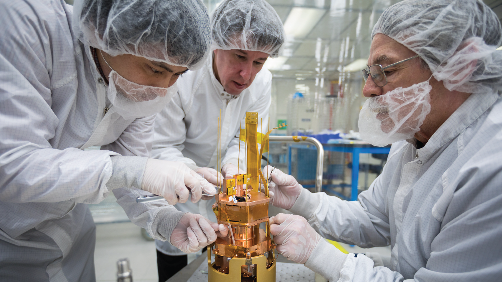 From left: SLAC's Tsuguo Aramak, Paul Brink and Mike Racine are performing final adjustments to the SuperCDMS SNOLAB engineering