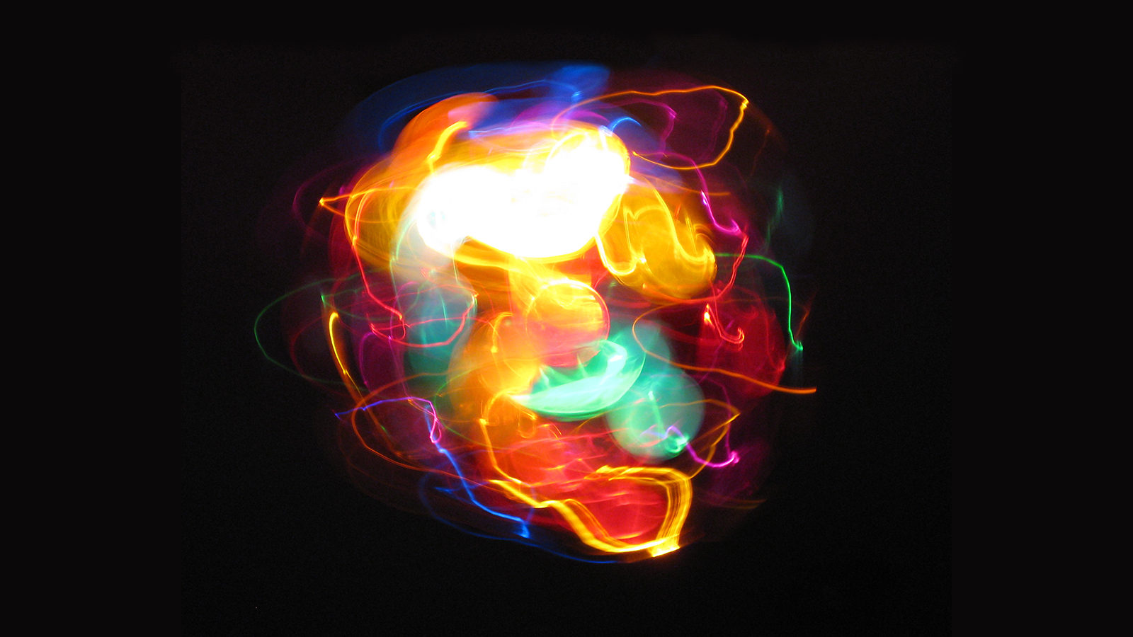 Long-exposure photo showing many colors of light