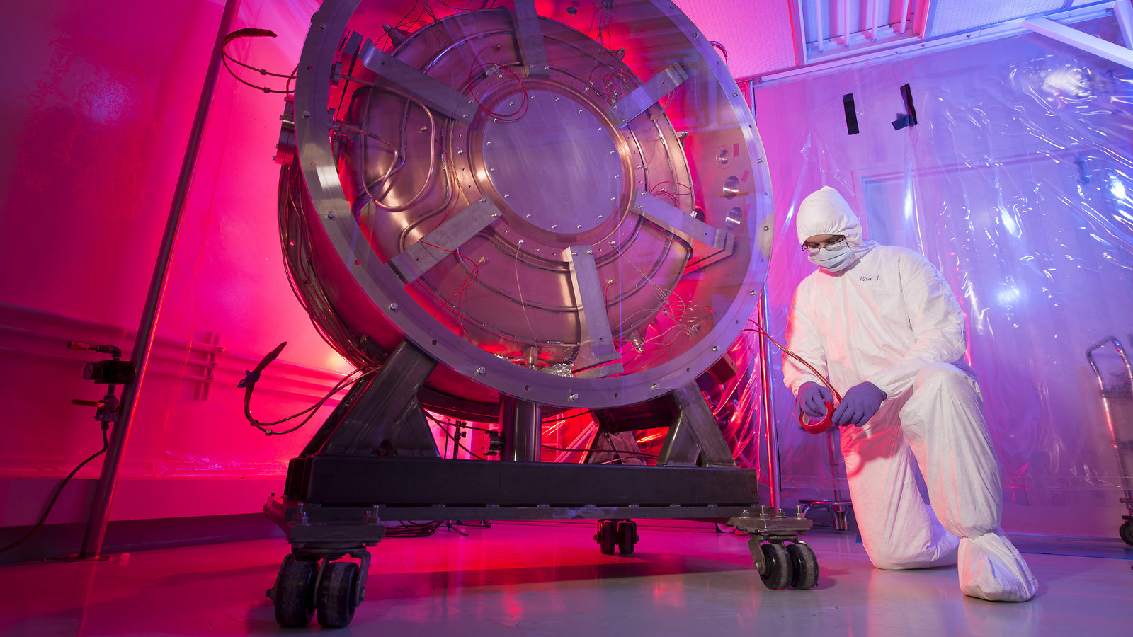 Scientist working on a new particle collider