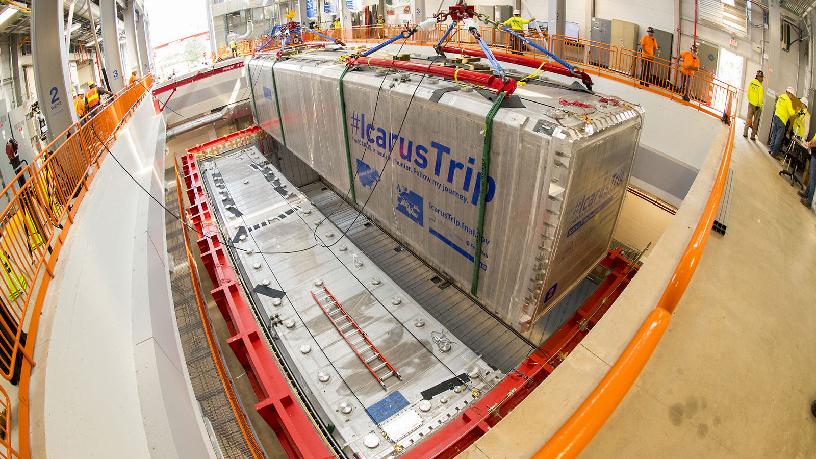 The second silver module of the ICARUS detector is lowered into its container.
