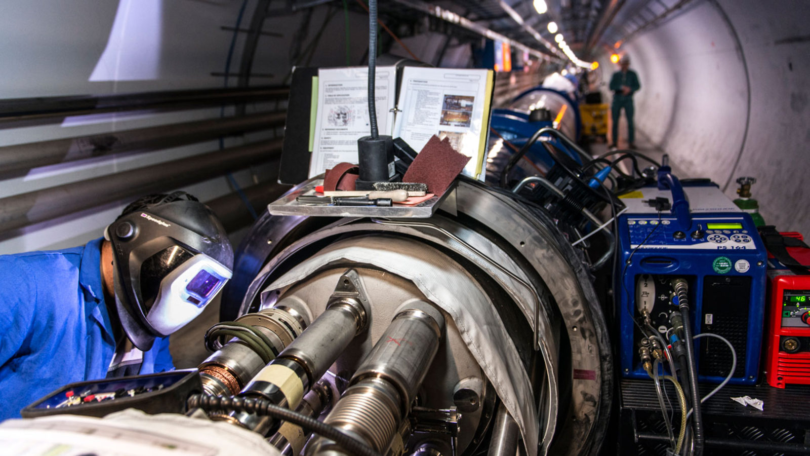 Maintenance workers working on LHC Accelerator