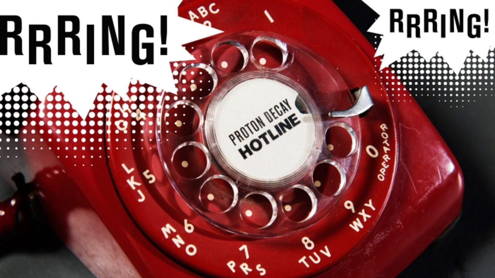 "Photo of old red dial telephone that says ""Rrring!"""