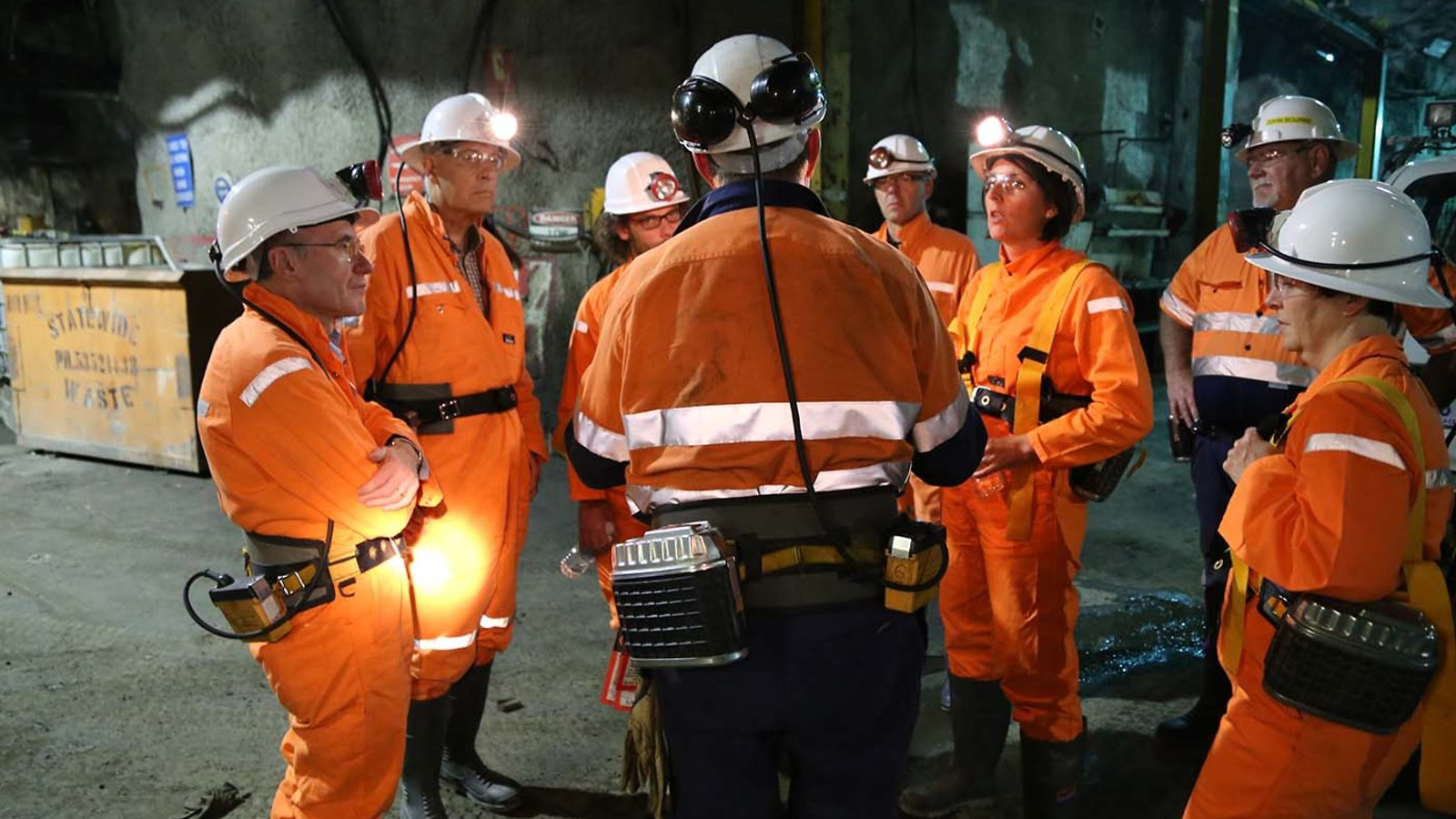 Rob Stewart of the Stawell Gold Mine (center, back turned), talks to scientists during a tour of the mine.