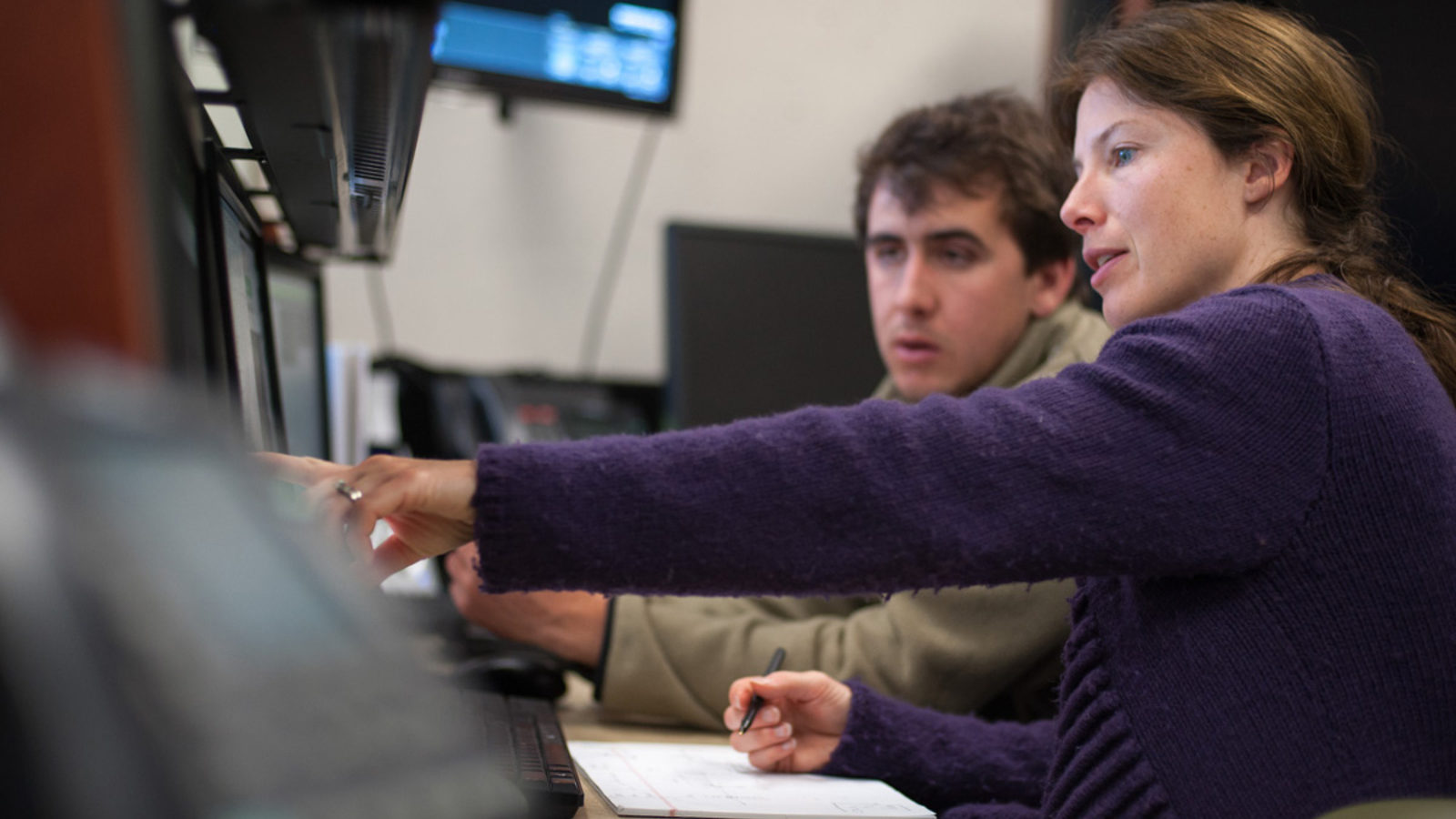 Photo of LCLS engineering physicistSilke Nelson, right, shows intern Tyler Couto how to operate a controls system