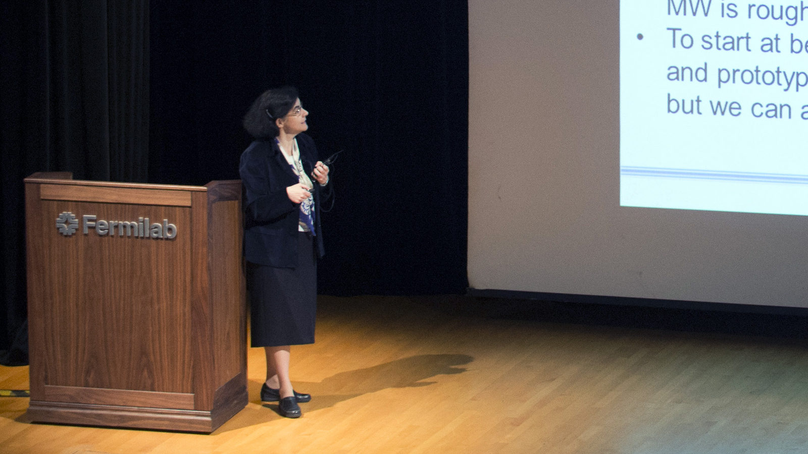 Photo of physicist giving speech at Fermilab