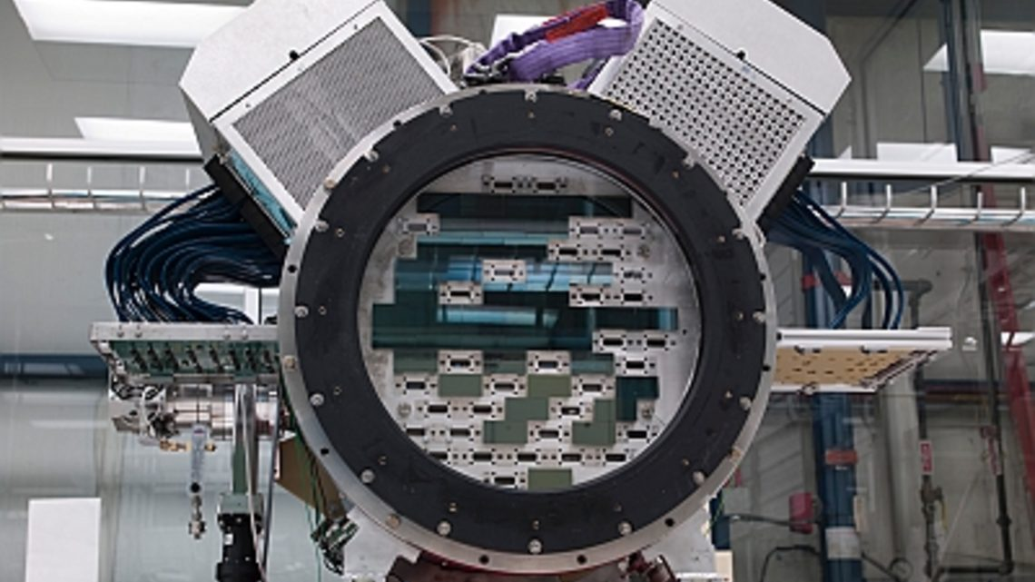 Photo of technicians at Fermilab assembled the Dark Energy Camera in a cleanroom