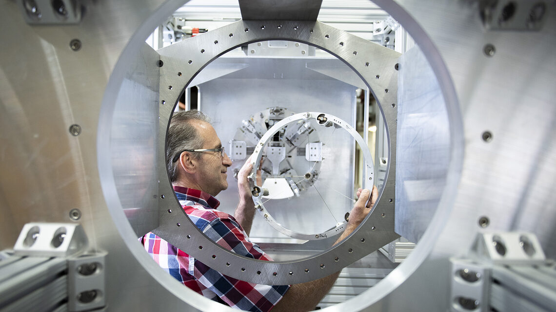 Fermilab engineer Mike Campbell handles the target for the Mu2e experiment.
