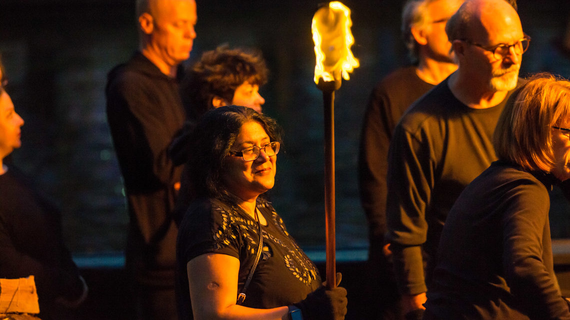 Brown University physicist and organizer of the Big Bang Science Fair Meenakshi Narain stands with a lit torch