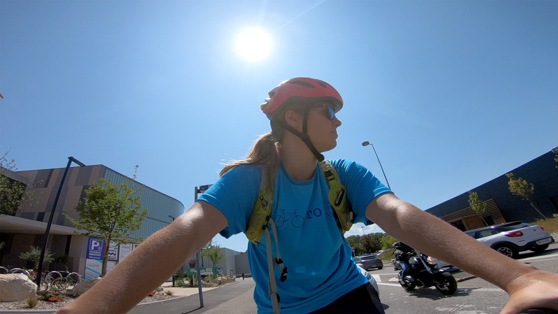 Sarah bikes through the commercial center near LHCb.