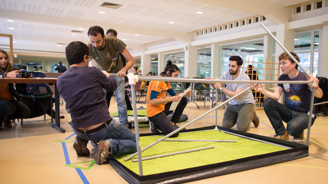 Group of people working on putting a table together
