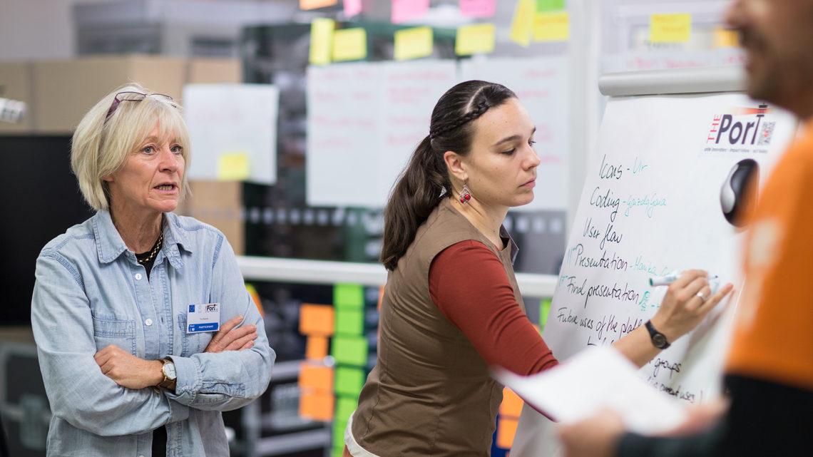 People working on large notepad brainstorming