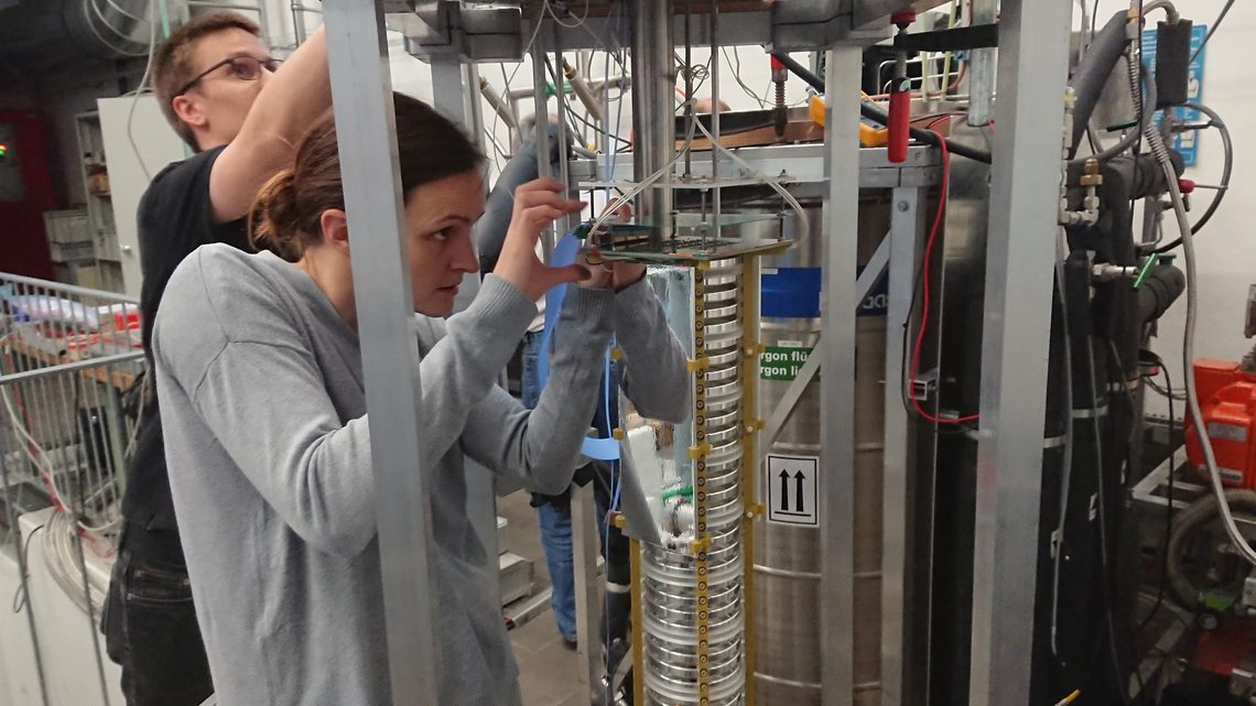 Researchers assemble components in the test detector at the University of Bern.