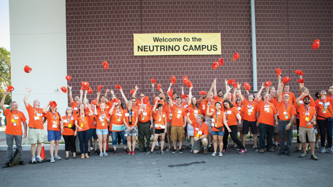 Part of the volunteer team at the neutrino campus breaks from sharing science for an exuberant group photo.