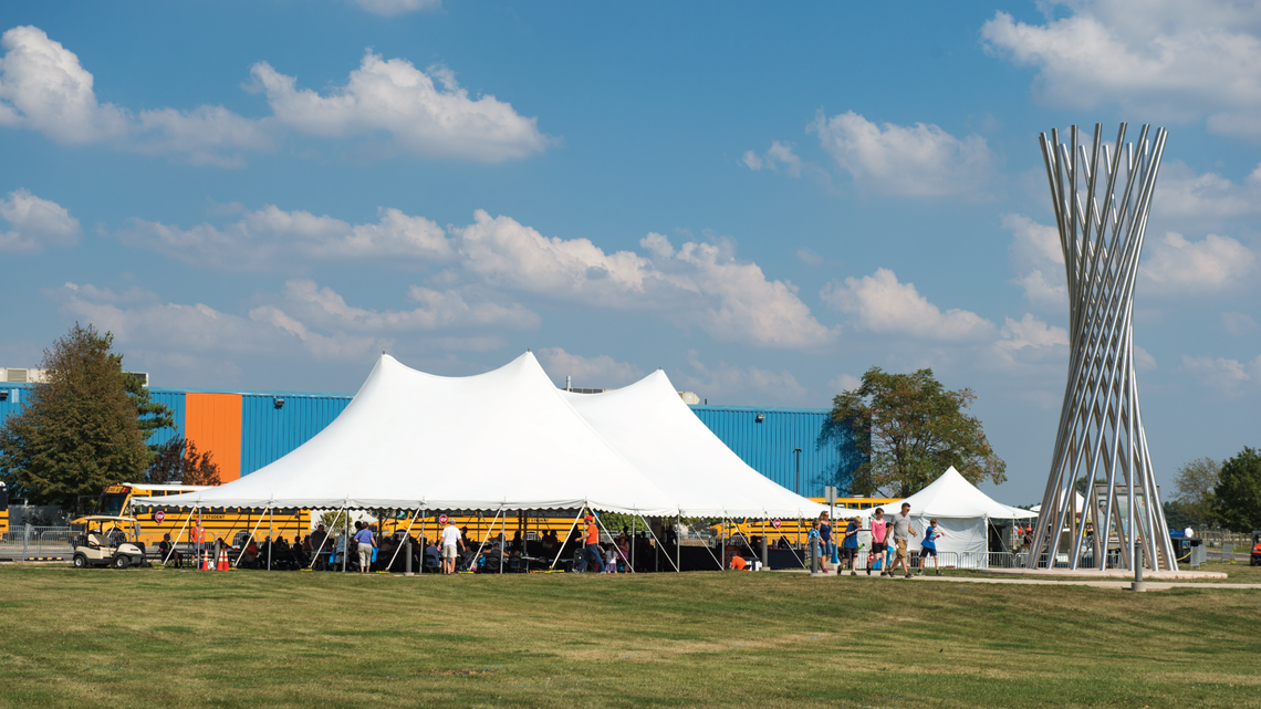 Tents erected for the celebration provided welcome shade from which to view the campus, including the tall Tractricious sculptur
