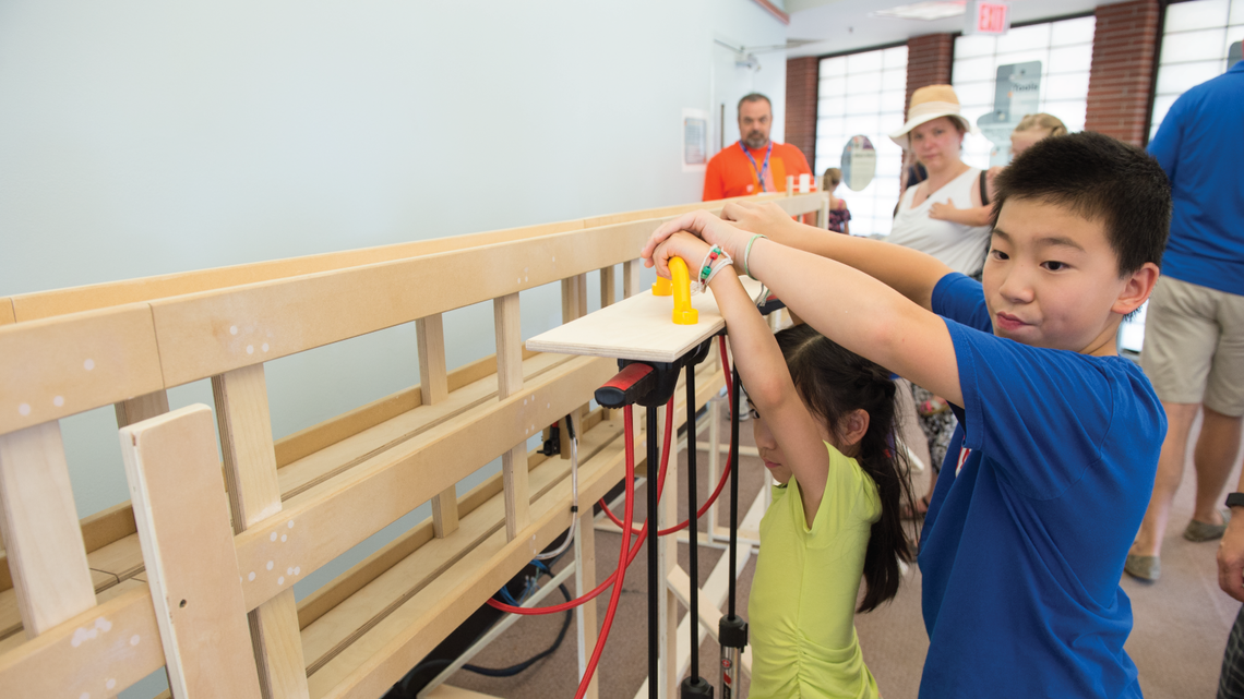 Hundreds of young scientists experimented with hands-on demos at the Lederman Science Center.