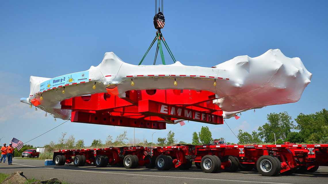 Photo of workers used a massive crane to move the Muon g-2 electromagnet from the trailer of a specially adapted truck