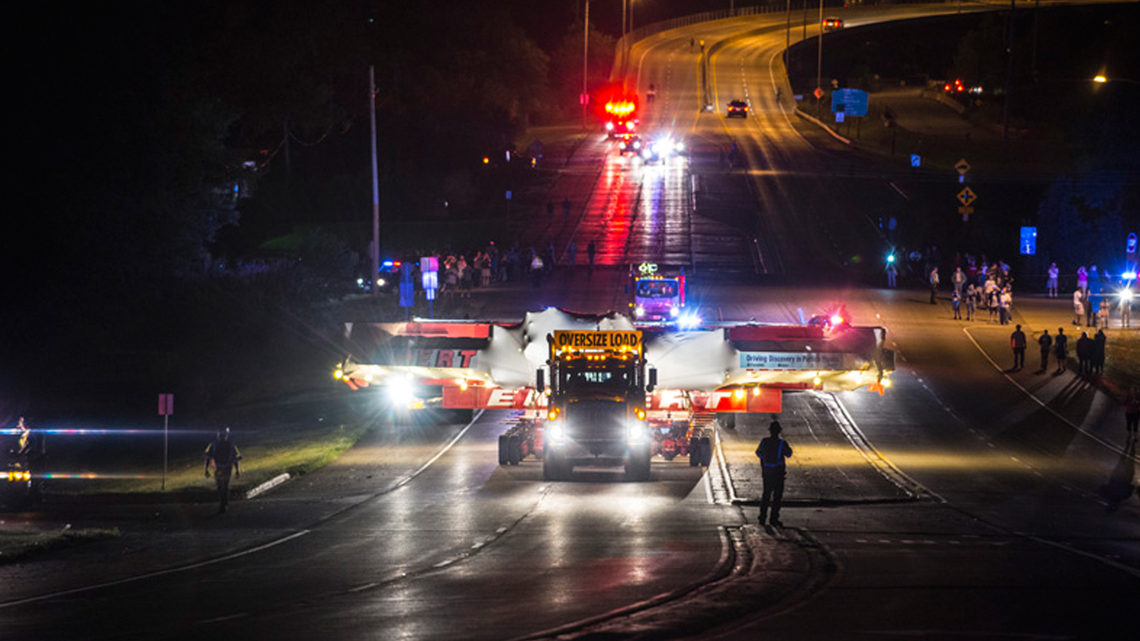 Photo showing Muon g-2 electromagnet was slowly driven through Lemont, Illinois, on July 23 while local residents watched