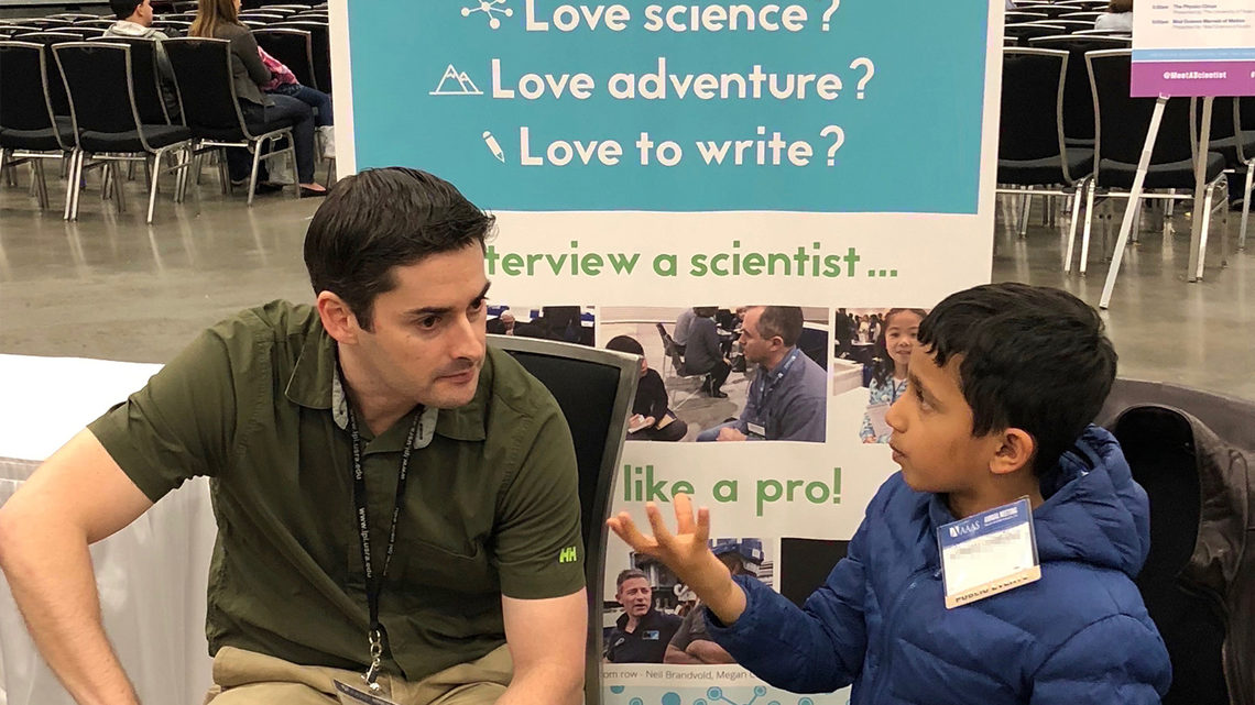 Young interviewer with a scientist