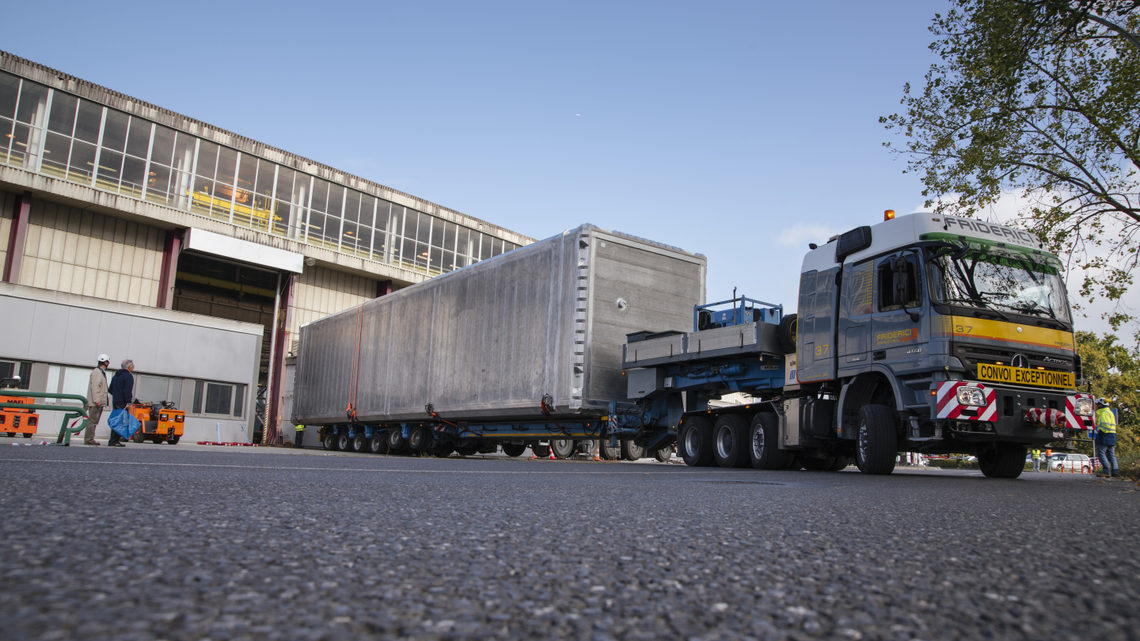 The ICARUS detector being transported by truck to another location at CERN.