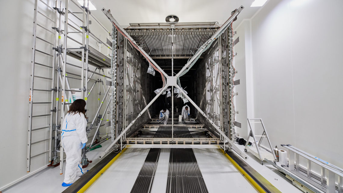 Photograph of the ICARUS detector being loaded into its cryostat at CERN
